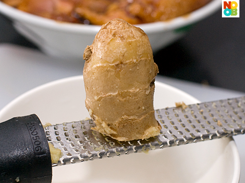 Grating ginger with a microplane