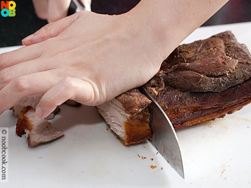 Making crispy roast pork (siu yuk)