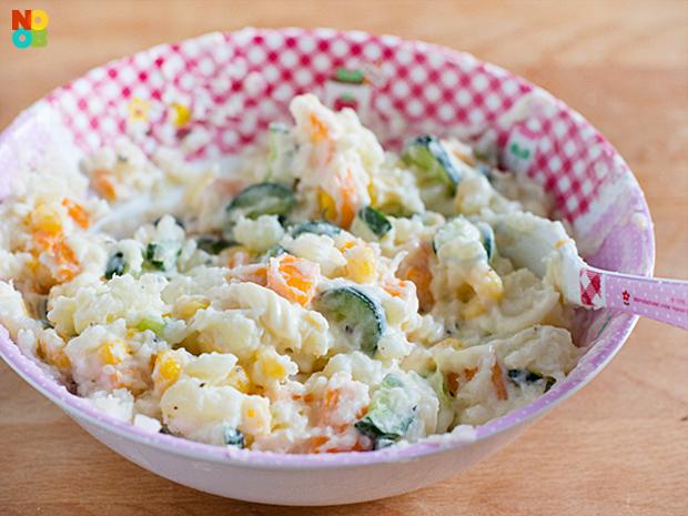 Mixing potato salad