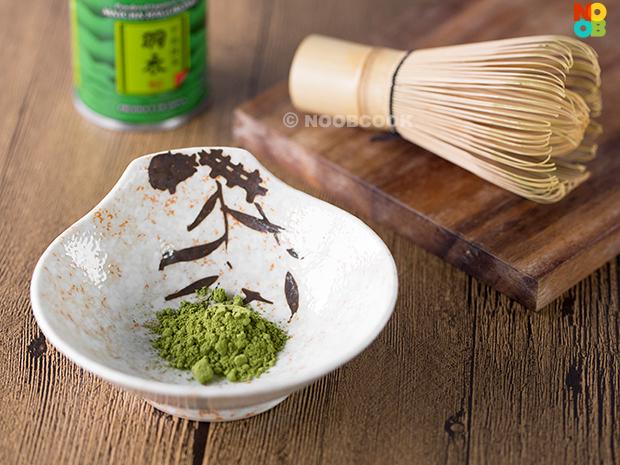 Matcha powder and bamboo tea whisk
